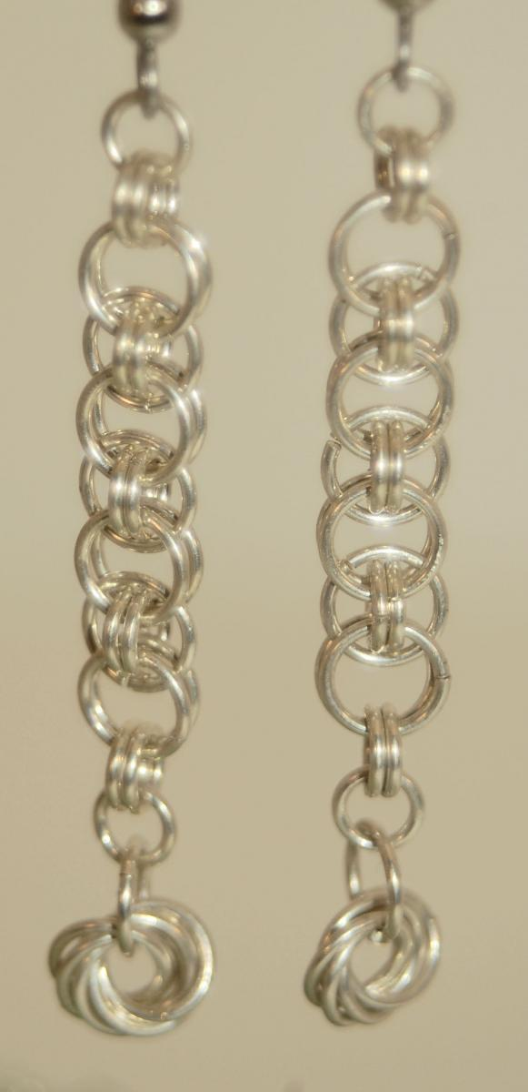 Helm w Moebius earrings in Fine Silver web.jpg