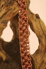 Rhino snorting Draino 2 strand opposite direction bracelet in copper web2.jpg