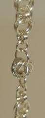 Helm bracelet w moebius center in fine silver web2.jpg