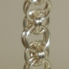 Helm bracelet w moebius center in fine silver web.jpg