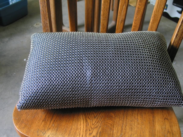 Welded stainless chainmail covered pillow we make for a Design company
