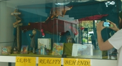 Scale mail Dragon hanging in library themed display cabinet