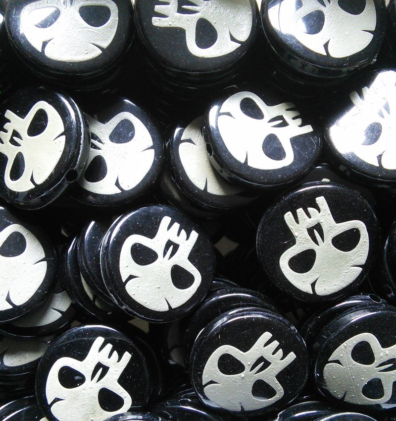 White Skulls engraved on Black Acrylic Beads