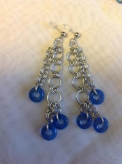 Earrings with blue glass donuts